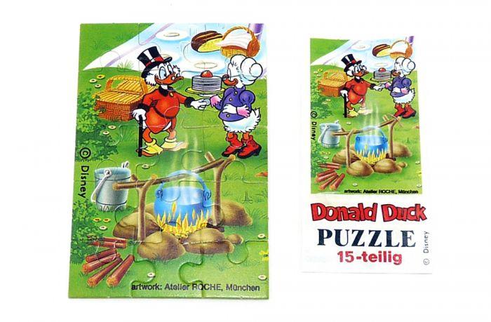 Puzzleecke unten links mit Beipackzettel von Donald Duck und Familie