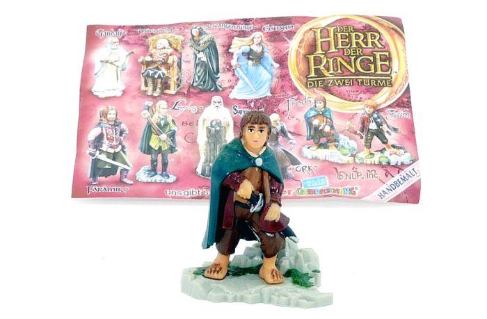 Frodo mit Beipackzettel und Tritt von Der Herr der Ringe Teil 2