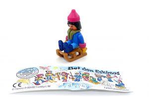 """Mädchen mit Schlitten als Steckfigur aus dem Satz """"Bei den Eskimos"""" von 1994 mit Beipackzettel"""