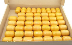 50 Ü-Ei Kapseln in orange - zweiteilig (Ü-Eier Kapsel)