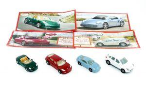 Satz Porsche Automodelle von 2011. KOLLEKTION 1 mit vier Beipackzetteln