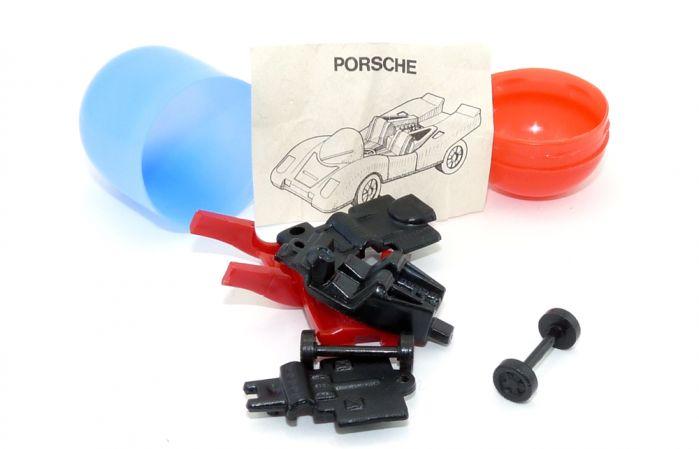 Porsche noch nicht zusammegebaut mit Zettel und blau roter Kapsel
